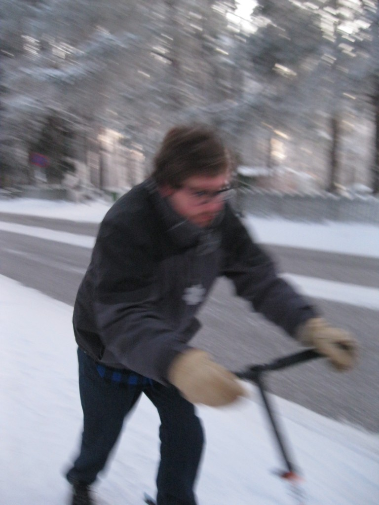 Brandon's kicksledding action shot